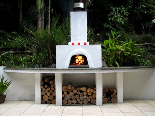 Wood-fired pizza oven, polished concrete bench-top