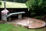 Wood-fired pizza oven, polished concrete bench-top, outdoor kitchen, landscaping
